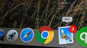 Photo of the task bar on a Mac computer showing icons, including the email icon