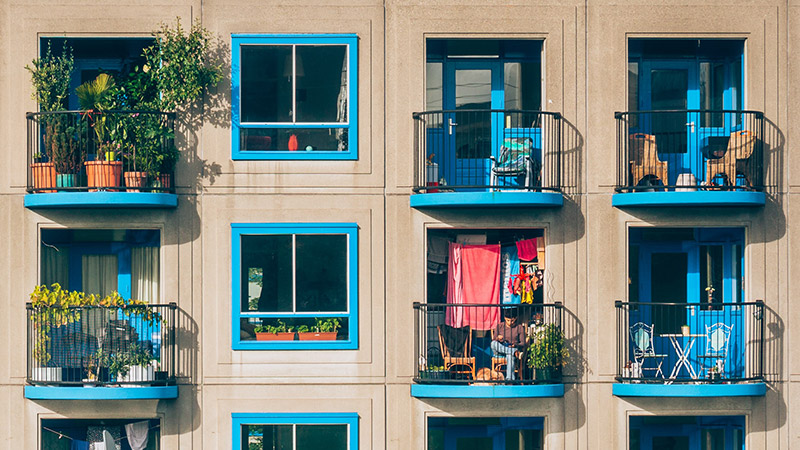 A photo of the balconies and windows of an apartment building