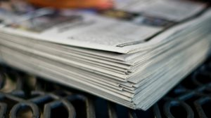A stack of newspapers on a table