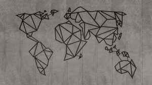 A geometric map of the world hanging on a concrete wall