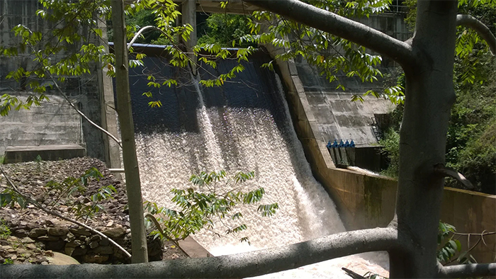 Photo of water flowing from the Ishasha Small Hydropower Project in Uganda