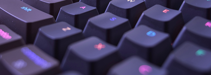 Part of a light-up keyboard, focusing mostly on the shift key, the A key, and the S key.