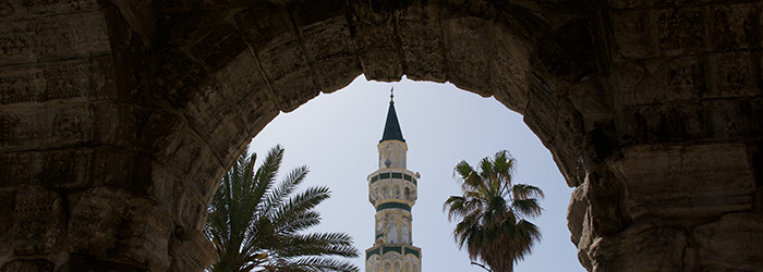 The Gurgi Mosque framed by the Arch of Marcus Aurelius in Tripoli, Libya.