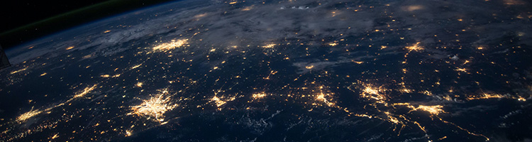 Photo of the United States from space, showing the cities lit up.