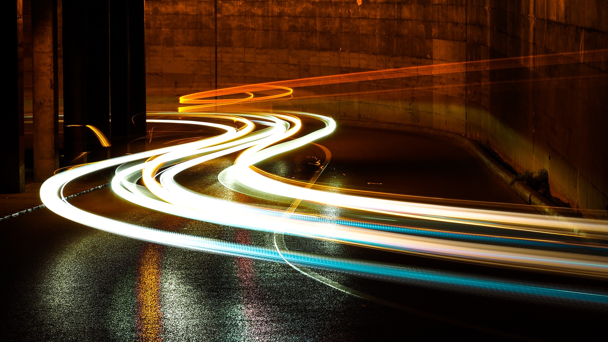 Time-lapse motion blur photo of traffic on a busy street
