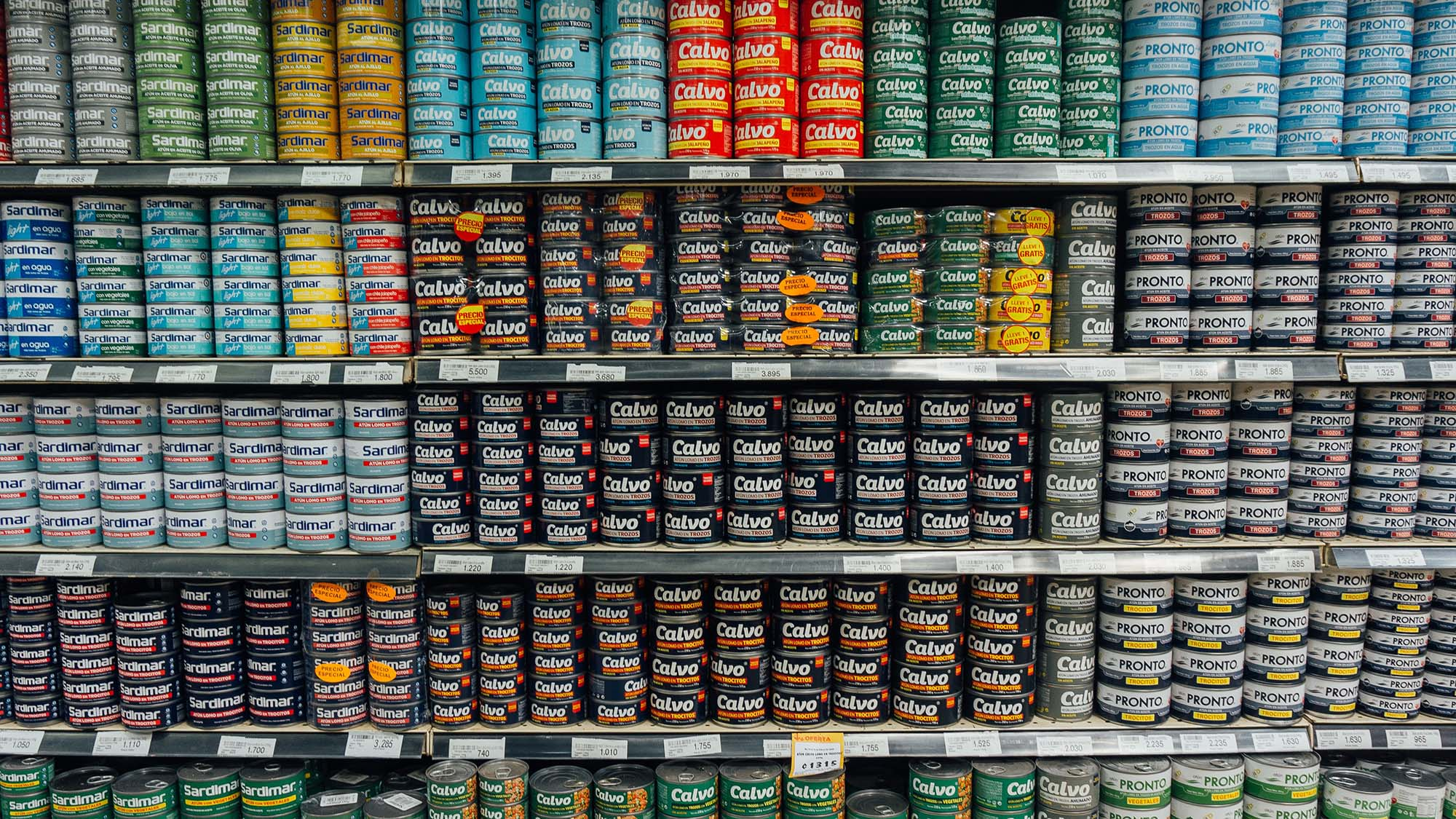 Cans of tuna fish stacked on shelves