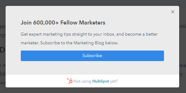 Screenshot of an exit-intent popup from HubSpot offering an option to subscribe to the marketing blog.