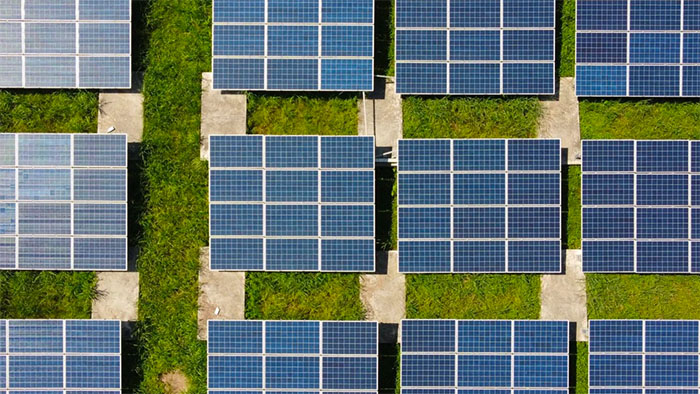Overhead photo of a grid of solar panels in a field in Southern Vietnam.